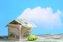 House built of money and a toy car Royalty Free Stock Images