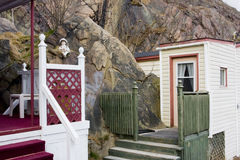 House built into rocks. House built into rock cliff in Newfoundland Stock Images