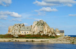 House built between two rocks in the north of Brittany, France. House between rocks Stock Image