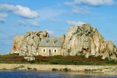 House built between two rocks in the north of Brittany, France. House between rocks Stock Photos