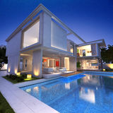 House bunker pool. External view of a contemporary house with pool at dusk Royalty Free Stock Photos