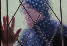 House Burglar Window Theft. House burglar by window with bars intruder blurred stock images