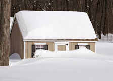 tan clubhouse buried in snow blizzard Stock Photos