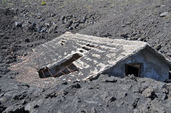 House buried under lava Stock Image