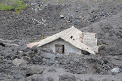House buried under lava Stock Photo
