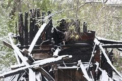 House burned down. snow and burnt Royalty Free Stock Images