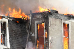 Top of house burning Stock Image