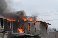 House burning, Iowa. Top of a house on fire, engulfed in flames Royalty Free Stock Photography