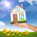 House on businesswomans hand Stock Images