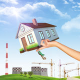House on businesswomans hand with NPP Stock Photography
