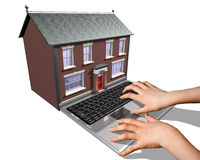 House-buying on the Internet. A laptop merged into a house representing the buying of a new home on the Internet Royalty Free Stock Photos