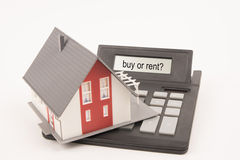House calculator buy or rent. House with a calculator and the words buy or rent royalty free stock photography
