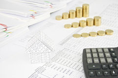 House and calculator with group step pile of gold coins Royalty Free Stock Image