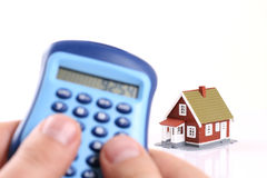House and calculator in hand. Stock Photos