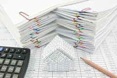 House and calculator with pencil Royalty Free Stock Photo