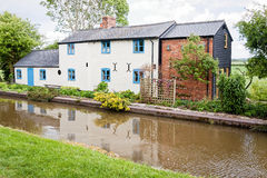 House on a Canal. A cottage on the banks of the Shropshire Union Canal. England, UK royalty free stock photos