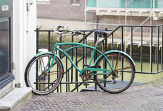 House and canal with green bike Stock Image