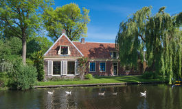 House at canal. Traditional dutch house along a canal Stock Photos