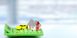 House with car and calculator. Stock Photo