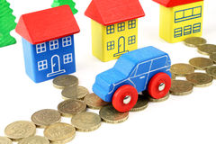 House & Car Costs. A general metaphor for all house and car finances Royalty Free Stock Photography