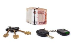 House and car key with pile of rolled cash money white background Stock Photo