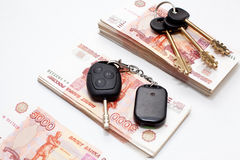 House and car keys on money Royalty Free Stock Images