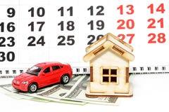 House, car and money on a background calendar Royalty Free Stock Photos