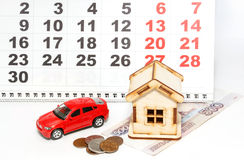 House, car and money on a background calendar Stock Image