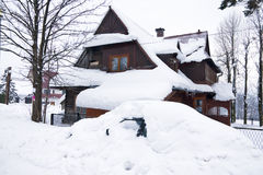 House and car under snow in the Tatra mountain village Polish Stock Photo