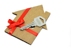 House from cardboard with ribbon stock illustration