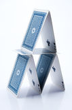 House of Cards. Small house of cards (ace, 2 and 3 visible) with blue backs Royalty Free Stock Image