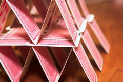 House of cards. On a wooden table (very shallow Depth of Field Royalty Free Stock Photo