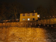House on castle wall by night Stock Images