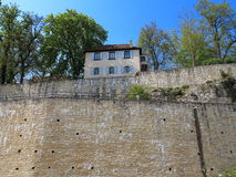 House on castle wall royalty free stock photography