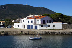 House and Catalan boat in Cadaques Royalty Free Stock Image