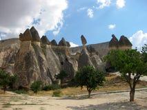 House caves at Cappadocia Turkey. House caves and trees at Cappadocia Turkey Royalty Free Stock Photography