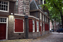 House in the centre of Amsterdam. House  brown brick with red shutters in the centre of Amsterdam Stock Photography