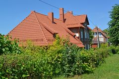 The house with a ceramic tile roof. Settlement Amber, Kaliningrad region.  Royalty Free Stock Photos