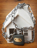 House with chain and padlock, Royalty Free Stock Photo