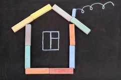 House from a chalk on a black Stock Photography