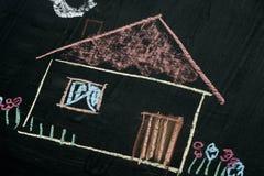 House chalk drawing on blackboard selective focus macro Stock Photography