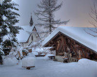 House and chapel under the snow Royalty Free Stock Photos