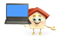 House character with laptop Royalty Free Stock Photography