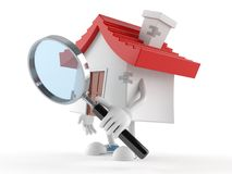 House character looking through magnifying glass. On white background Stock Photography