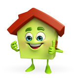 House character with thumbs up sign Stock Photos