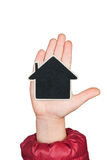 House in a child's hand with space for your text Stock Photography