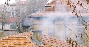 House Chimney With Smoke. Small House Chimney With Smoke Cinematic stock footage
