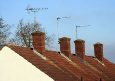 House chimneys. With antennas on the roof Stock Photography