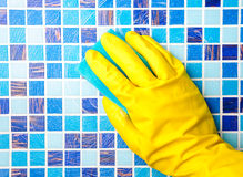House chores - cleaning bathroom   with sponge Royalty Free Stock Images