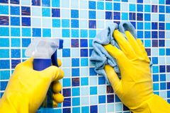 Free House Chores - Wiping Bathroom Wall With Cleaning Cloth And Spr Royalty Free Stock Photography - 99674497
